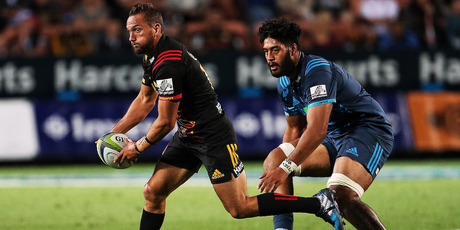 iefs' first five Aaron Cruden against Akira Ioane of the Blues. Photo / Photosport