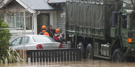 sidents were rescued from their flooded homes in Christchurch yesterday as a state of emergency was called in the city and the Heathcote River rose. Photo/AP/Mark Baker