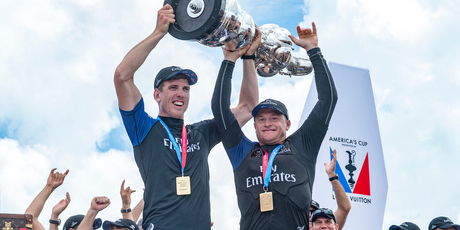 am New Zealand helmsman Peter Burling and skipper Glenn Ashby hold aloft the America's Cup. Photosport