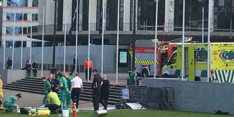 ergency services help the man outside Parliament yesterday. Photo / Matthew Taylor