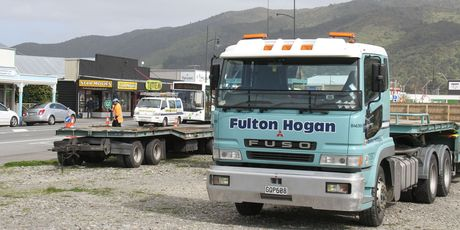 lton Hogan trucks park on Featherston's 'shingle pit' while resealing works are carried out. Photo / File