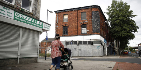 pedestrian walks past derelict shops in Hull, United Kingdom. The UK faces its longest fall in living standards since records began 60 years ago. Photo / Bloomberg